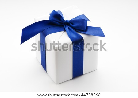 white surprise gift box with blue ribbon on white background - stock photo