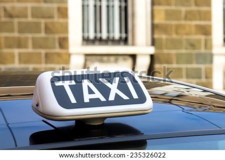 white symbol of the taxi on a car - stock photo