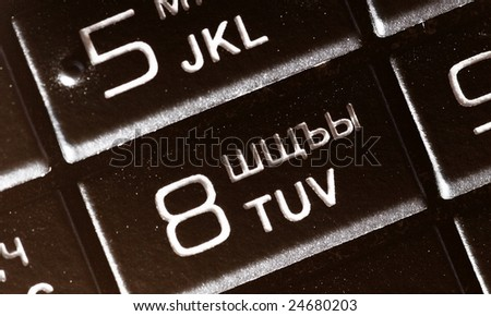 white symbols on black button of the keyboard