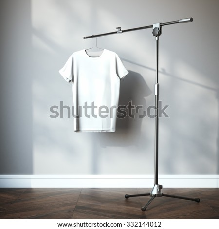 White t-shirt hanging on the tripod. 3d rendering - stock photo