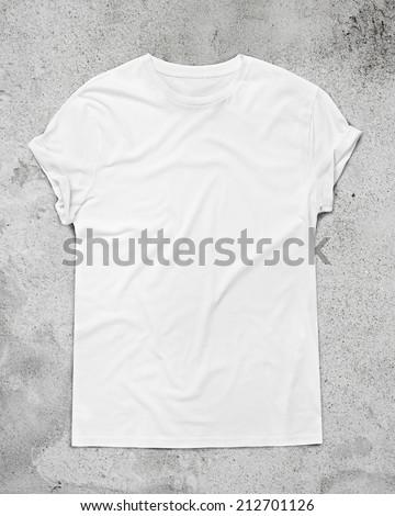 White t-shirt on concrete floor - stock photo