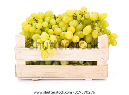 White table grapes (Vitis) in wooden crate on white - stock photo