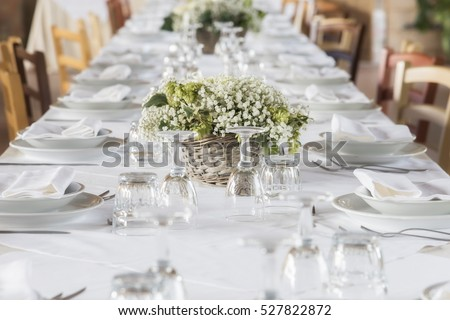 white table set for party