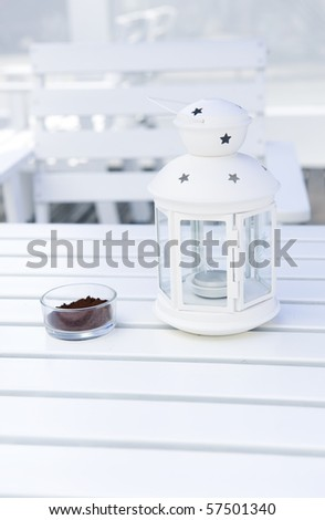 white table with beautiful lamp and ashtray on the surface, beautiful scene of resort. - stock photo
