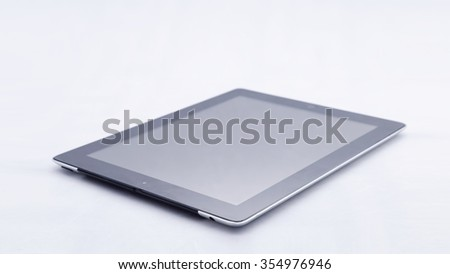 White tablet computer on over white background - stock photo