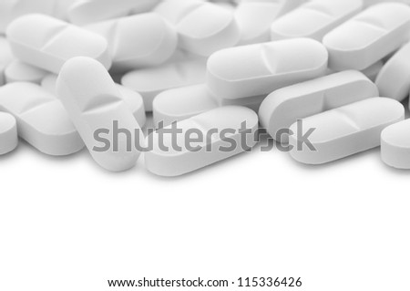 White tablet pills with copy space , isolated - stock photo
