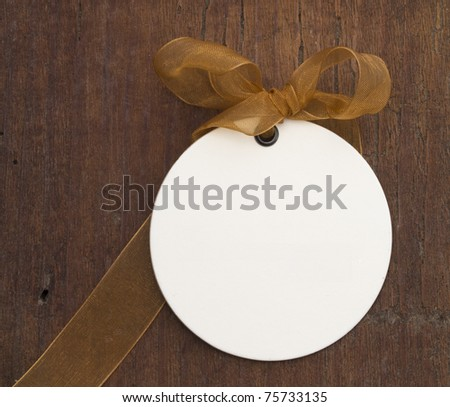 white tag on the wooden background - stock photo