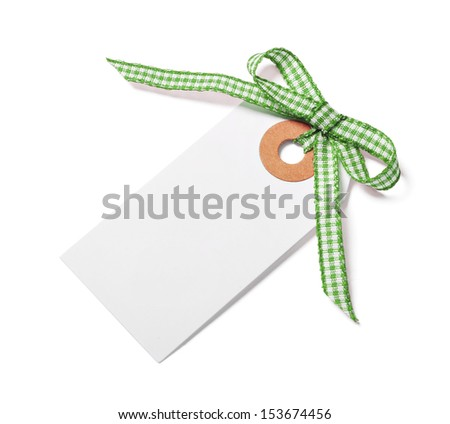 White tag with green ribbon bow isolated on white - stock photo