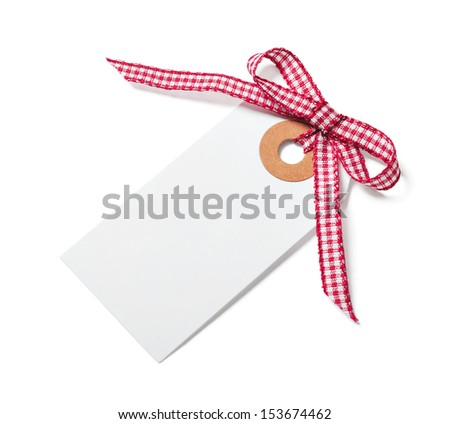 White tag with red ribbon bow isolated on white - stock photo
