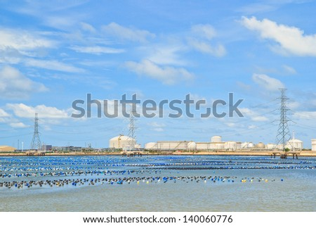 white tank in tank farm with blue sky - stock photo