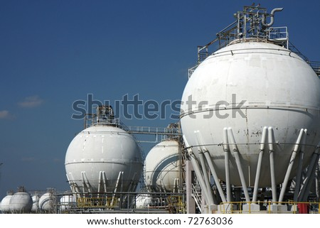 white  tanks of big crude oil refinery - stock photo