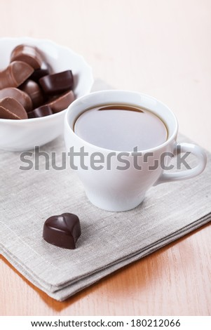 White tea cub with chocolate sweets