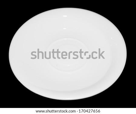 white tea saucer on a black background - stock photo