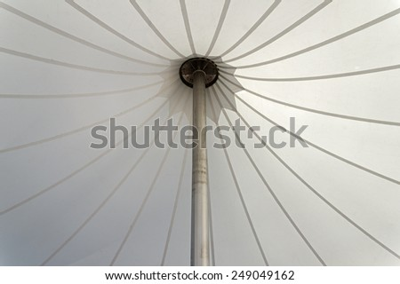 white tent canopy supported by an aluminum pole - stock photo