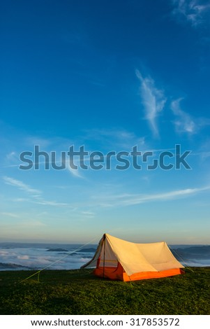 White Tent on the top of a Mountain with a Beautiful Blue Sky - stock photo