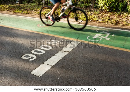 White text 900 meters and on the road with bicycle path - stock photo
