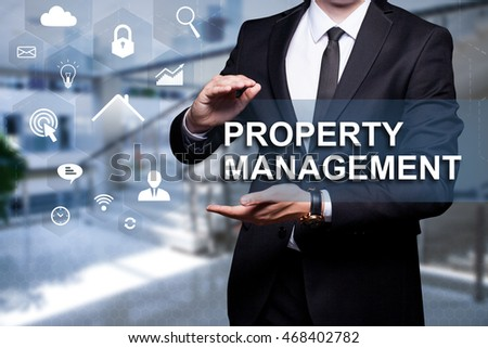 "White text with icon ""Property Management"" in the hands of a businessman. Business concept. Internet concept."