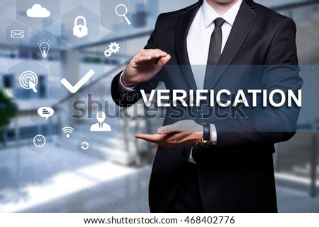 "White text with icon ""Verification"" in the hands of a businessman. Business concept. Internet concept."