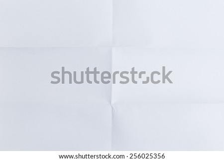 white textured sheet of paper folded in six , background - stock photo