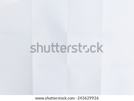 white textured sheet of paper folded in sixteen , background - stock photo