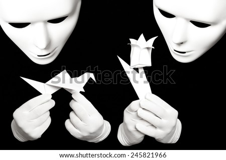 White theatrical mask and paper origami isolated on black - stock photo