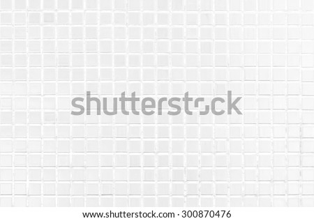 White tile modern wall background in toilet. Gay glass mosaic texture with light in top. Table pattern for scene and backdrop.
