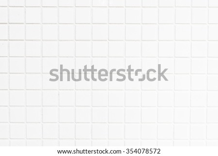White tiles wall textures for background - stock photo