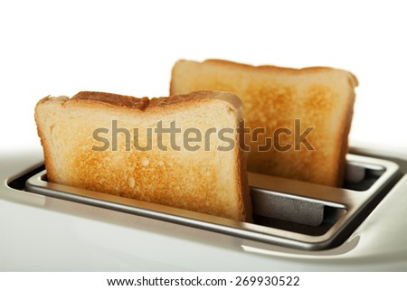 White toaster with two slices of bread - stock photo