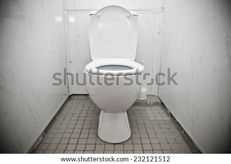 White toilet bowl in a bathroom  - stock photo