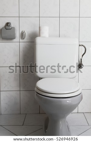 White toilet bowl in a bathroom (photo)