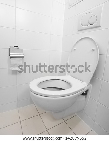 White toilet bowl in a modern bathroom. - stock photo