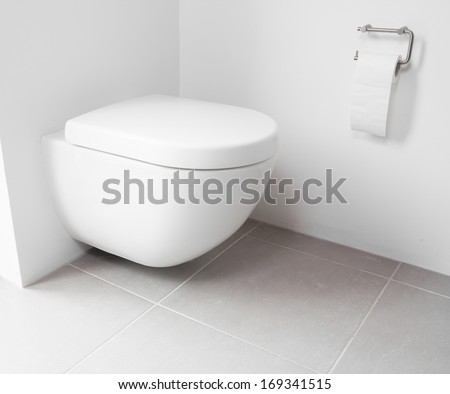 White toilet hanging on a white wall
