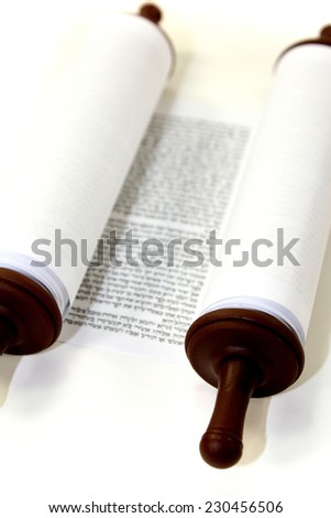 white Torah scroll on a light background - stock photo
