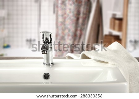 white towel and sink  - stock photo