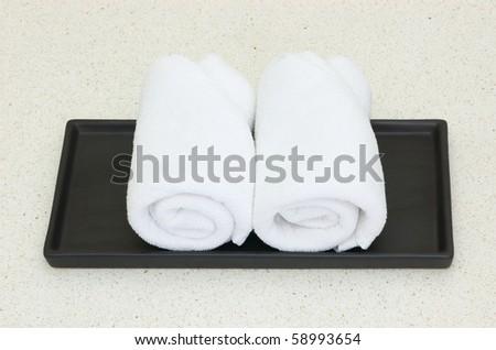 white towel on black tray - stock photo