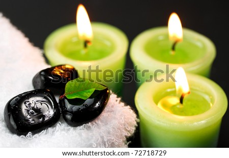 White towels with spa black stones and candles