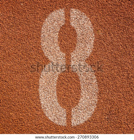 White track number on red rubber racetrack. textured running race tracks in outdoor stadium. - stock photo