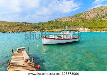 White traditional fishing boat on sea water in Posidonio bay, Samos island, Greece - stock photo