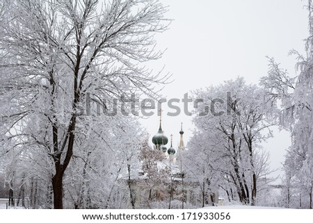 White trees and church in winter in Uglich  - stock photo