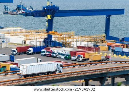 white truck near sea and ship - stock photo