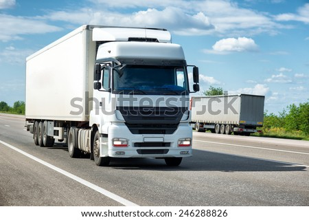White truck on road. Cargo transportation - stock photo