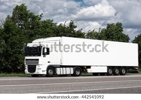 White truck on road. Cargo transportation - stock photo