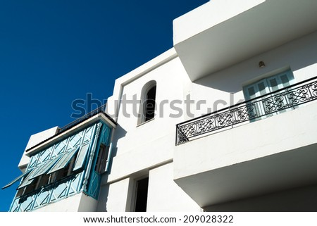 White Tunisian Home with Blue Shutters - stock photo