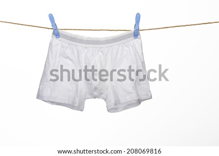 white underwear on a string against white background - stock photo