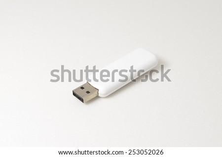 White USB Pendrive. Shoot over white background. Shallow depth of field. Focus on the USB connector. - stock photo