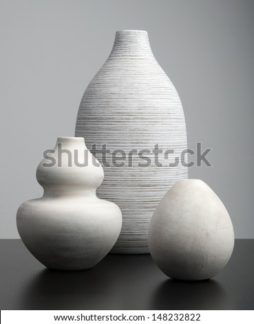 White Vases on a dark surface - stock photo