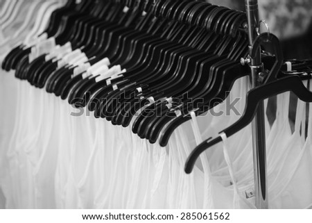 white vest hanger background,  looking through new clothes during shopping,Colorful women's dresses on wood hangers in a retail shop. Fashion and shopping business concept. lace