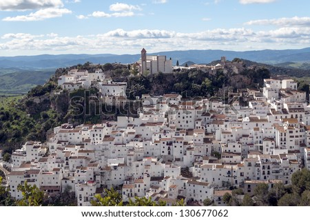 White village called casares located in the Spanish province of Malaga is surrounded by mountains, see the town from a viewpoint in the top of the village you can see the church and the castle
