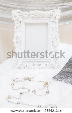 white vintage frame on  table for decoration in wedding reception - stock photo