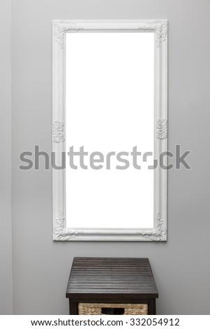 white vintage mirror frame on the gray wall - stock photo